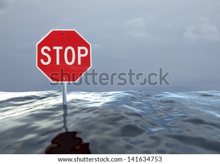 Concept image of a stop sign at a flooded intersection - stock photo