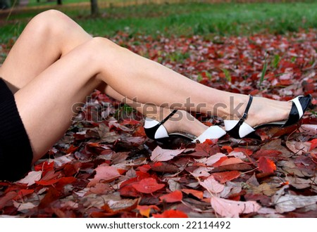 Concept image of a woman's attractive legs. Shallow depth of field focus point is at models  legs. - stock photo