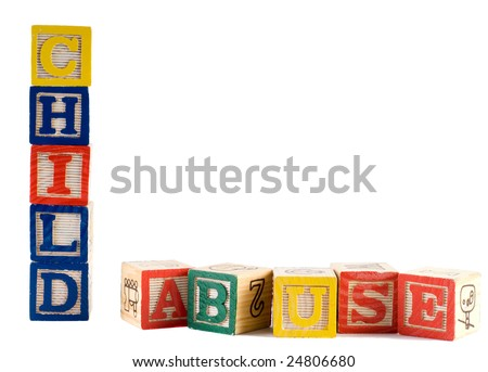 Concept image of child abuse, by spelling it out with wooden letter blocks - stock photo
