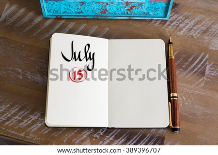 Concept image of July 15 Calendar Day with empty space for text as handwritten note with fountain pen on a notebook - stock photo
