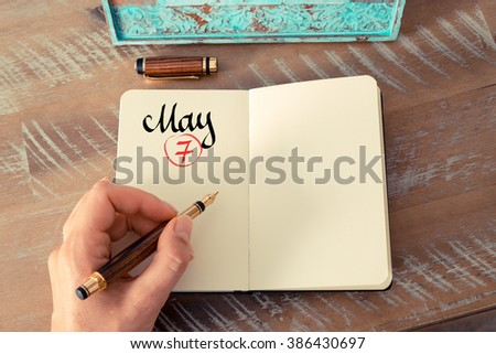 Concept image of May 7 Calendar Day with empty space for text as handwritten note with fountain pen on a notebook - stock photo