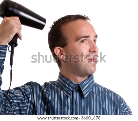 Concept image of metrosexual male featuring a young male using a hair dryer to fix his hair nicely, isolated against a white background - stock photo
