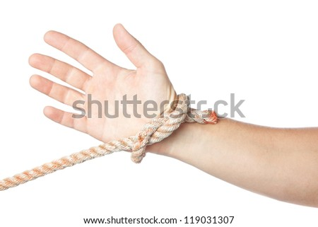 Concept image, tied hand on a white background. - stock photo