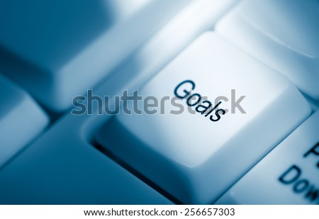 Concept image with goals on computer keyboard - stock photo