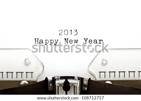 Concept image with 2013 Happy New Year written on an old typewriter - stock photo