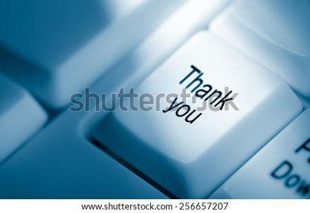 Concept image with thank you on computer keyboard - stock photo