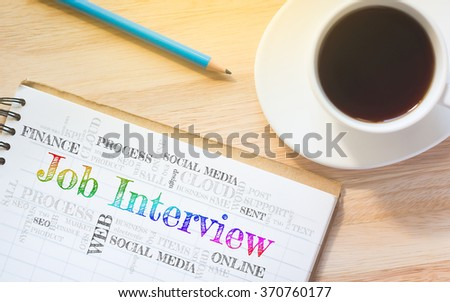 Concept Job Interview message on book. A pencil and a glass coffee table.Vintage tone. - stock photo