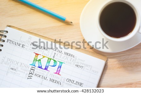 Concept KPI or Key Performance Indicator button message on book. A pencil and a glass coffee table.Vintage tone. - stock photo