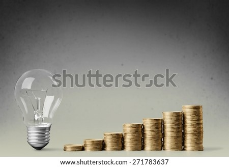 Concept. Light bulb with heap of coins stairs for financial plan or business idea concept - stock photo