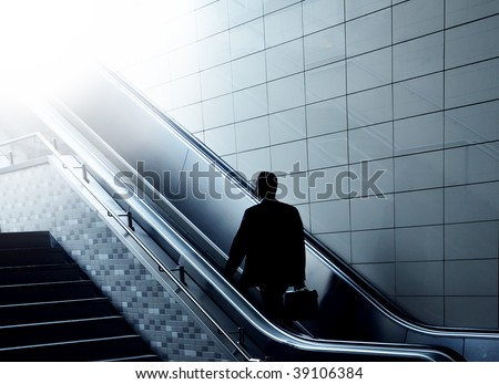 Concept of a businessman going to heaven on an escalator. Perfect shot for your religion or transportation advertising! - stock photo
