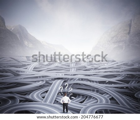 Concept of a businessman in front of a confusion of road - stock photo