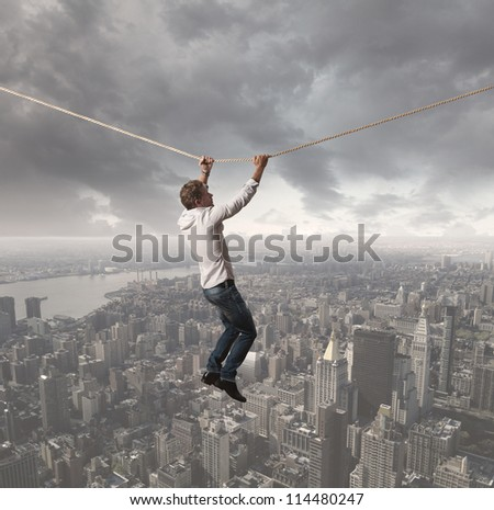 Concept of a businessman that challenges the difficulties - stock photo
