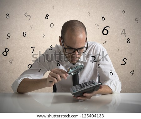 Concept of a businessman that checks the numbers and earnings - stock photo