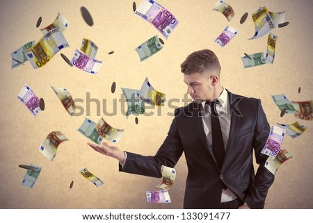 Concept of a businessman that earns money - stock photo
