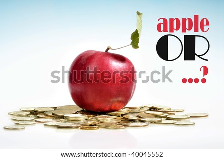 Concept of a red apple and a lot of golden coins on white background - stock photo