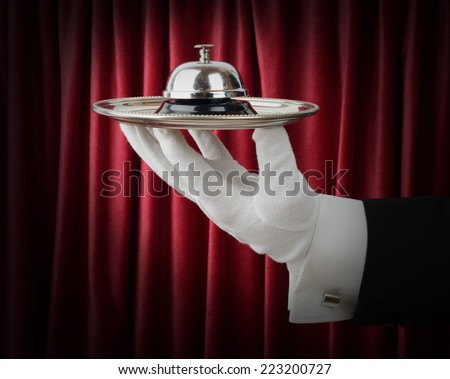 Concept of a waiter or butler offering a service - stock photo