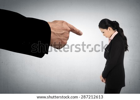 Concept of accused business woman with fingers pointing - stock photo