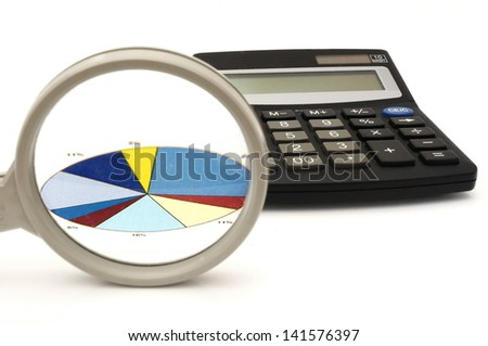 concept of analyzing in office with magnifier,calculator,graph - stock photo