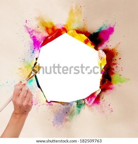 Concept of art with blank ripped paper and woman hand holding paintbrush. Free space for text - stock photo