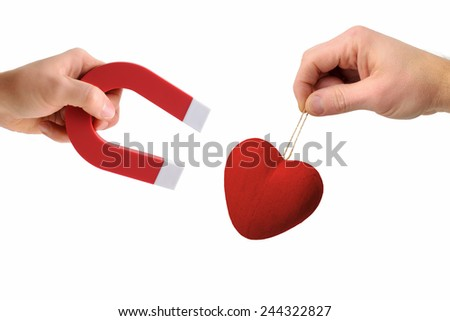 Concept of attracting another's heart isolated on white - stock photo