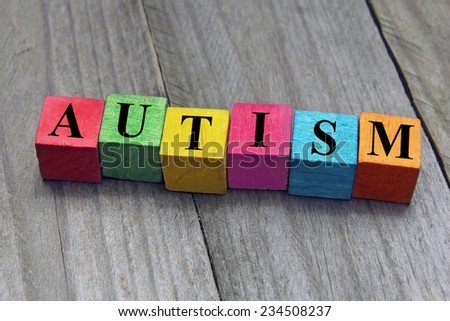 concept of autism word on wooden cubes - stock photo