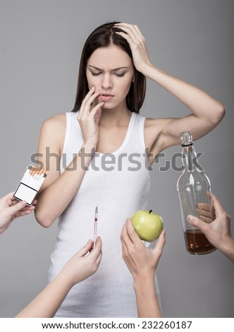 Concept of bad habits. A young woman, alcohol, drugs, tobacco. Young girl struggling with her bad habits. - stock photo