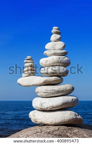Concept of balance and harmony. White rocks zen on the sea - stock photo