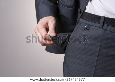 Concept of bankruptcy - empty pocket on a gray background. - stock photo