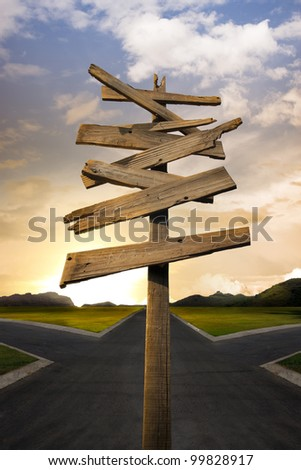 Concept of being lost with a roadsign, crossroads - stock photo