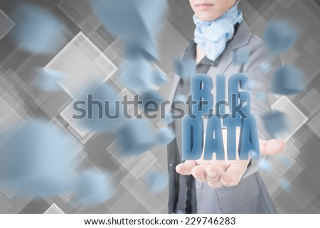 Concept of big data, business woman holding a 3d text. - stock photo