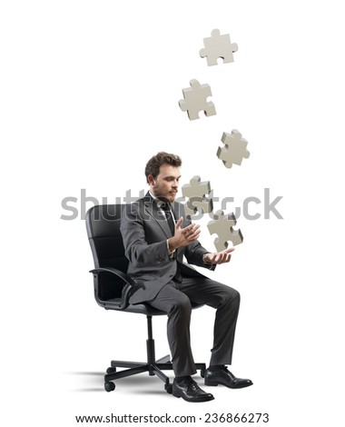 Concept of business game with juggler businessman with puzzle - stock photo