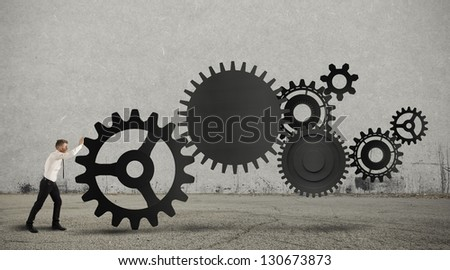 Concept of business in action with gear system - stock photo