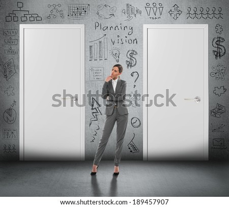 Concept of businesswoman planning her business strategy and choosing the right option - stock photo