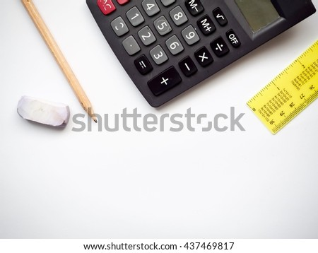 Concept of calculation with calculator, ruler, and pencil on white background, top view  - stock photo