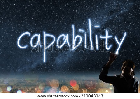 Concept of capability, silhouette asian business woman light drawing. - stock photo