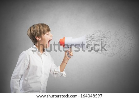 Concept of child screaming on the megaphone - stock photo