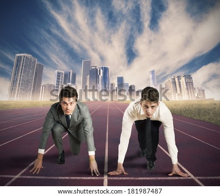 Concept of competition in business with businessman ready to start - stock photo
