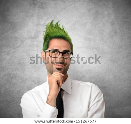 Concept of creative businessman with green hair - stock photo
