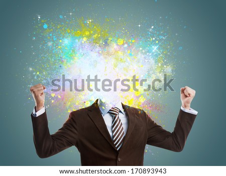 Concept of creative idea of a businessman. Colorful splashes streaming out of him. No head - stock photo
