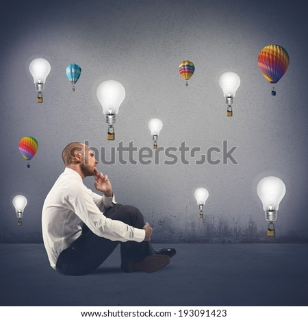 Concept of creativity of a businessman with flying idea - stock photo
