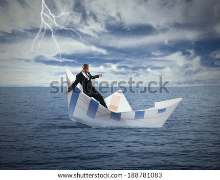 Concept of crisis and economic collapse with sinking boat - stock photo
