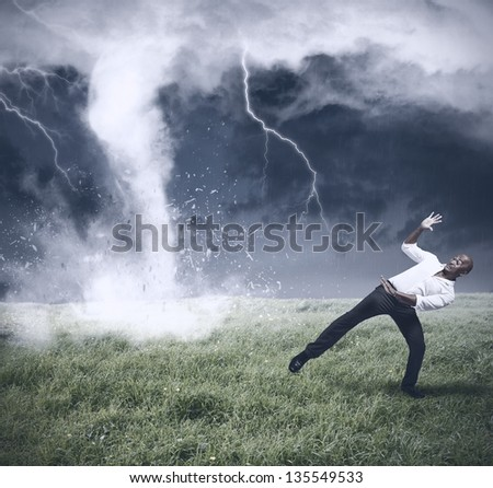 Concept of crisis with storm and tornado - stock photo