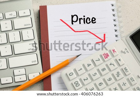 concept of decreasing price with calculator and desk background - stock photo