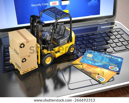 Concept of delivering, shipping or logistics. Forklift on laptop keyboard and credit cards. 3d - stock photo