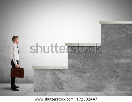 Concept of difficult career of a businessman with big stairs - stock photo