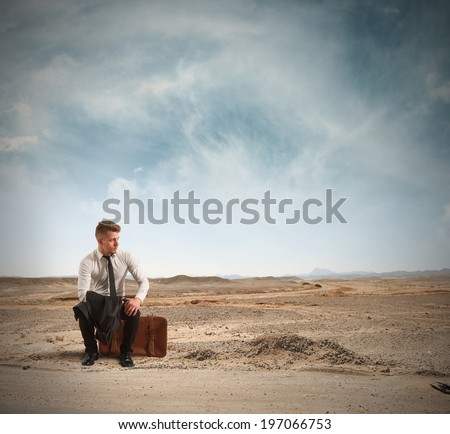 Concept of discharged businessman in the street - stock photo