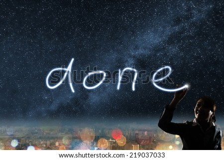 Concept of done, silhouette asian business woman light drawing. - stock photo