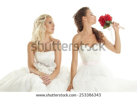 Concept of double wedding. Two sexy brides posing - stock photo