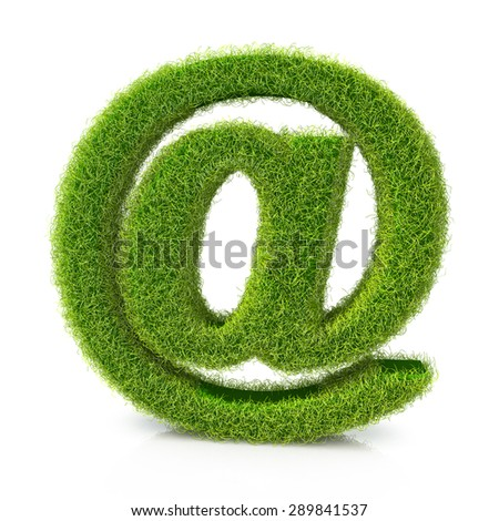 Concept of e-mail symbol covered grass - stock photo