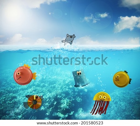 Concept of ecology with funny fish made;from recycled material - stock photo